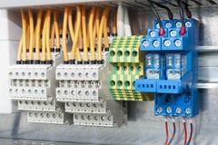 Electrical terminal blocks on bar Royalty Free Stock Image