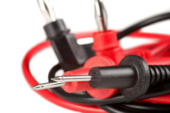 Electrical Test Probes. Pointed electrical test probes with red and black leads, banana plugs in background Stock Image