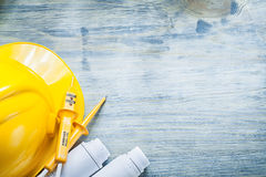 Electrical tester safety hard hat construction drawings on woode Royalty Free Stock Image