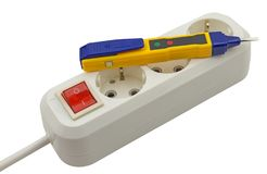 Electrical tester screwdriver and Electric extension on white Stock Photography
