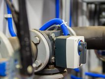 Electrical three-way mixing valve on a pipes in boiler room. Selective focus Royalty Free Stock Images