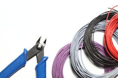Electrical tool. Some colorful wire rolls with side cutter royalty free stock photo