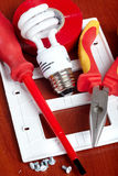 Electrical tools. Bulbs,  tape, light switch Royalty Free Stock Images