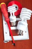 Electrical tools. Bulbs,  tape, light switch Stock Photos