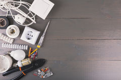 Electrical tools and equipment on wooden table with copy space royalty free stock images