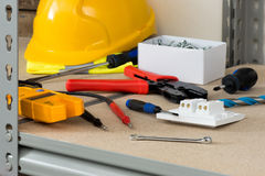 Electrical Tools and Supplies on Cork-Covered Shelving Stock Photography