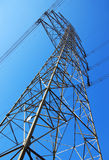 Electrical Tower. A tall electrical tower over a blue sky background Stock Photography