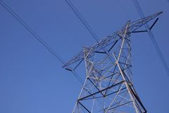 Electrical Tower 2. High-tension electrical tower against a clear blue sky Stock Photography