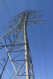 Electrical tower. And wires against blue sky Royalty Free Stock Photography