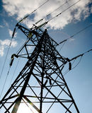 Electrical tower. On a background of the blue sky Royalty Free Stock Images