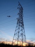 Electrical Tower. This shot of an electrical tower was taken during sunset as a jet came into view stock images