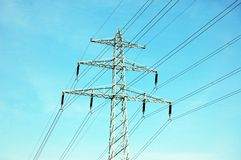 Electrical tower. And lines on background of blue sky Royalty Free Stock Photo
