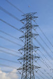 Electrical tower against blue sky and cloud Royalty Free Stock Photos