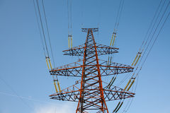 Electrical tower as monster. Energy transmission from power plant to customers Stock Photos
