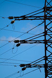 Electrical tower on a background of the blue sky. Electricity is a engine of human society. We use it everyday Stock Image