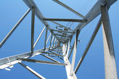 Electrical tower. From below with blue sky at background Stock Photography