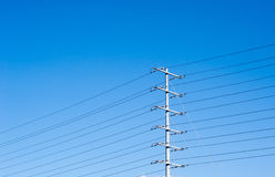 Electrical tower on blue sky with many power lines Royalty Free Stock Photos