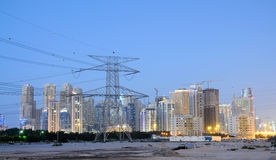 Electrical Tower and Dubai City Royalty Free Stock Photography