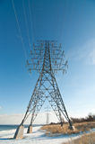 Electrical Tower (Electricity Pylon) beside a lake Stock Photo