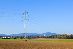 Electrical tower in field Royalty Free Stock Photo