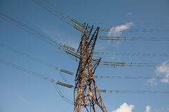 Electrical tower with insulators. Electricity is a engine of human society. We use it everyday Royalty Free Stock Photo