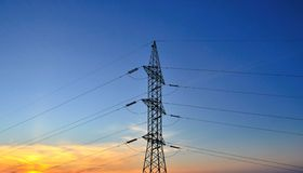 Electrical tower on intense sky background Stock Image