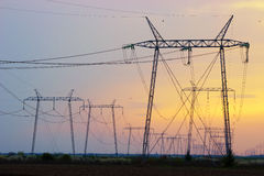 Electrical tower power pole in great sunset Royalty Free Stock Images