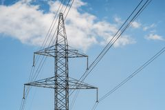 Electrical Tower Pylon And Wires On A Blue Sky With Clouds. Stock Image