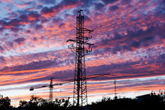 Electrical tower at sunset Stock Images