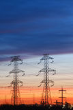 Electrical Towers with Colored Sky. Electrical towers are silhouetted against a colorful sunset sky with copy space Stock Image
