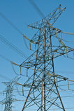 Electrical Towers (Electricity Pylons). A pair of electrical transmission towers carrying high voltage lines Royalty Free Stock Photos
