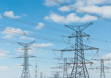 Electrical Towers (Electricity Pylons). A long line of electrical transmission towers carrying high voltage lines Royalty Free Stock Photos