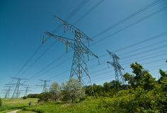 Electrical Towers (Electricity Pylons). A long line of electrical transmission towers carrying high voltage lines Royalty Free Stock Image