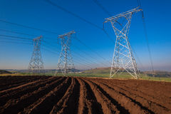Electrical Towers Cables Three Earth Royalty Free Stock Photography