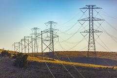 Electrical towers trailing far into the distance royalty free stock images