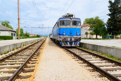 Electrical train on train station in eastern Europe Stock Photo