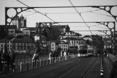 Electrical tram over the dom luis bridge in porto city of portugal in black and white stock photography