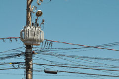 Electrical transformer on light pole with wires Stock Image