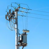 Electrical transformer to electrical pylon Royalty Free Stock Photography