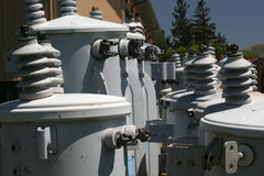 Electrical Transformers. Electric transformers wait for installation in an electric utility yard stock image