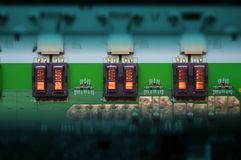 Electrical transformers aligned on PCB Royalty Free Stock Image
