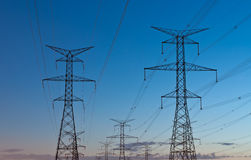 Electrical Transmission (Electricity Pylons). Electrical transmission towers carrying high voltage lines Royalty Free Stock Photos