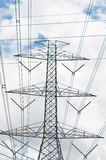 Electrical transmission tower. With cloud and sky royalty free stock photography