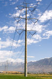 Electrical transmission  tower. A single, tall high voltage electrical transmission tower Stock Photo