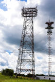 Electrical transmission tower. Electrical transmission tower landscape with cloudy sky stock images