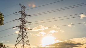 Electrical transmission tower. Landscape with sunset. Energy concept royalty free stock photos