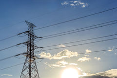 Electrical transmission tower. Landscape with sunset. Energy concept stock photo
