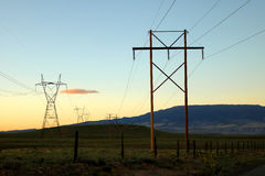Electrical Transmission Tower  and Power lines. Transmission towers at sunset Royalty Free Stock Photo