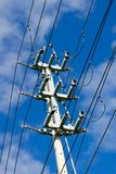Electrical transmission tower on sky. Electrical transmission tower and power lines on blue sky stock images