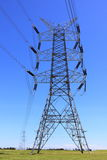 Transmission tower. Electrical transmission tower system. Australian countryside. Set against blue sky Royalty Free Stock Photo